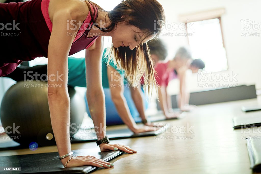 Targeting every muscle group with pilates stock photo