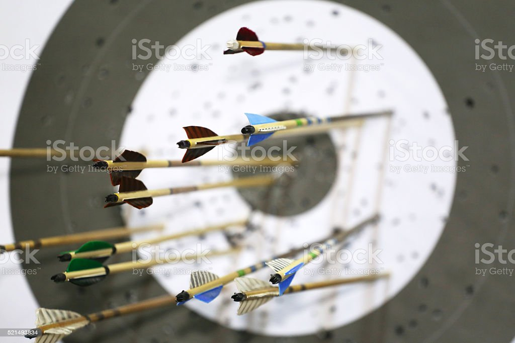 Targets at a bow shooting range with arrows in them stock photo