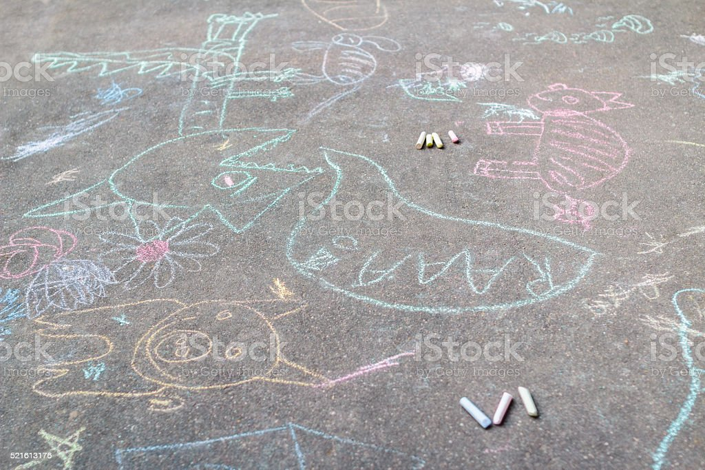 Tarmac covering with sidewalk chalking drawings stock photo