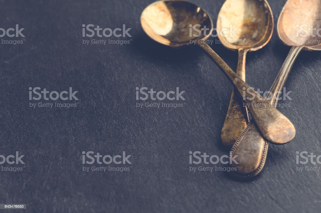 Tarnished silver vintage spoons. stock photo