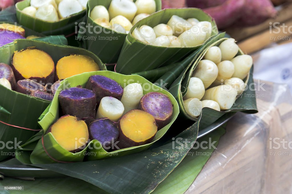 taro and yam in banana leave stock photo