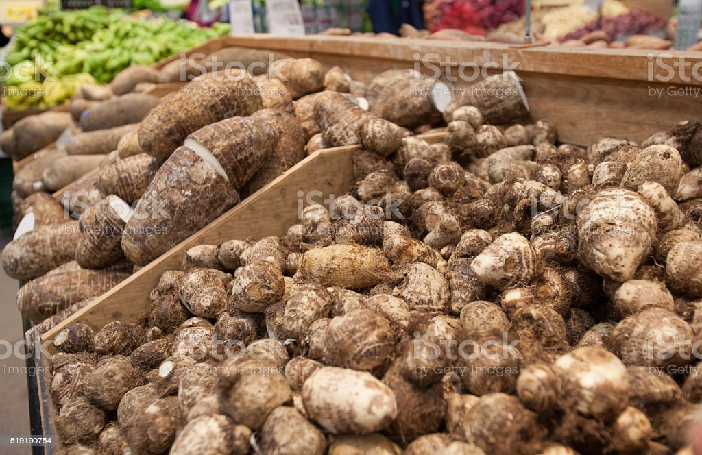Taro roots and yams on display at oriental grocery store stock photo