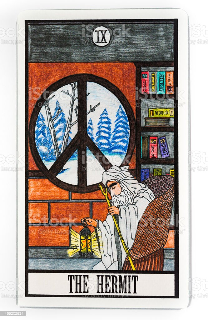 Tarot card with the hermit on its face stock photo