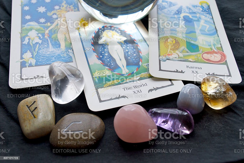 Tarot Reading with a Crystal Ball, Runes and Gemstones stock photo