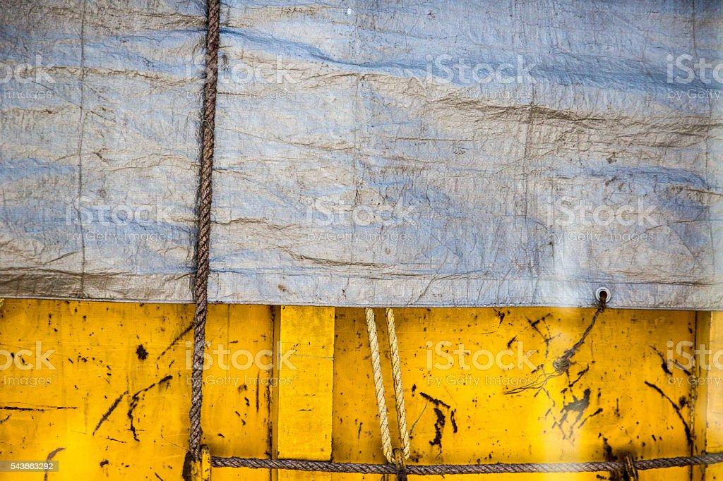 Tarp and yellow metal background stock photo