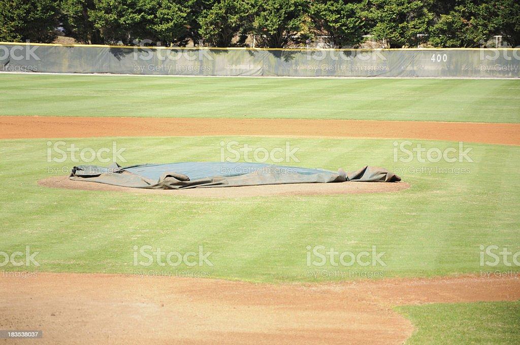 Tarp on pitchers mound royalty-free stock photo