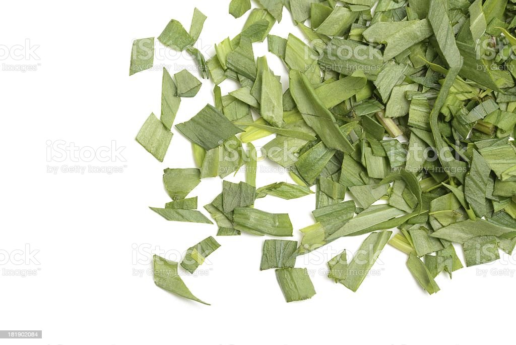 Tarragon leaves, chopped and scattered royalty-free stock photo