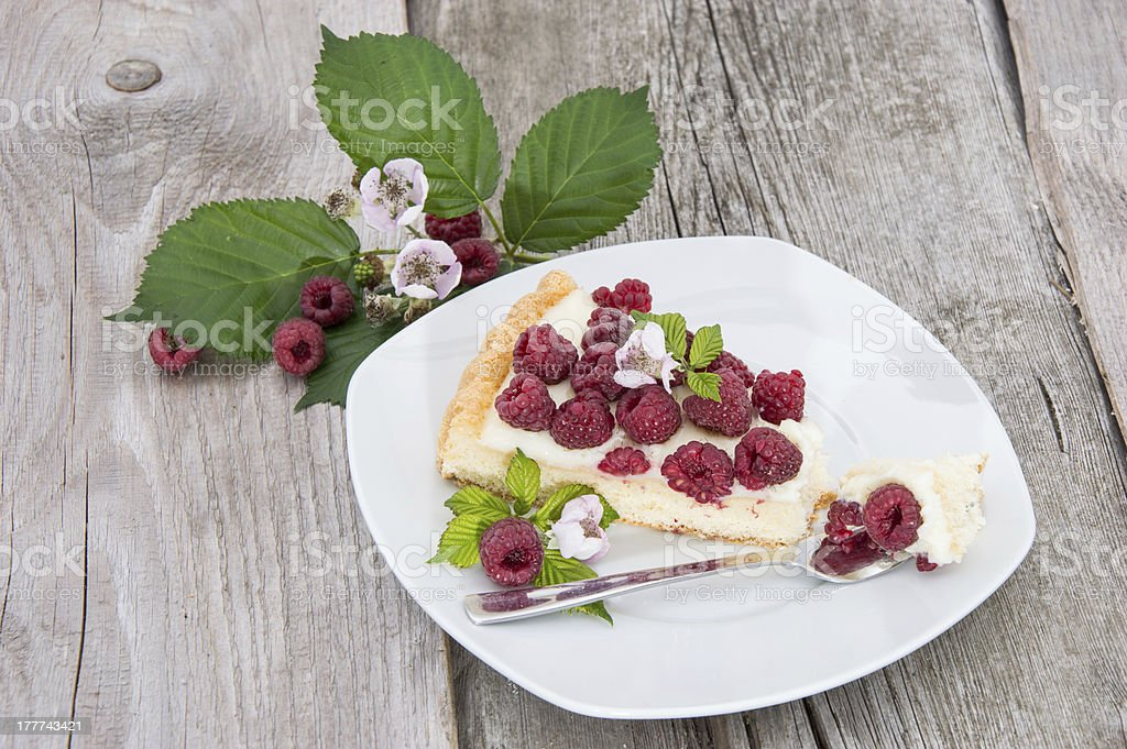 Tart on a plate against wooden background stock photo