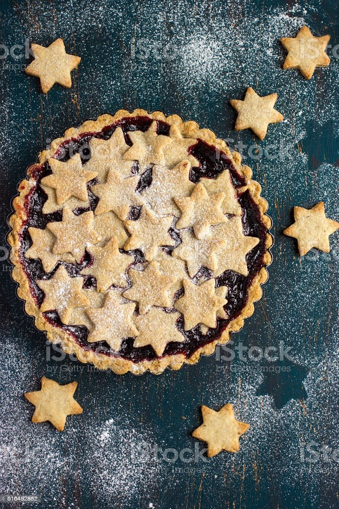 tart with berries jam and cookies stock photo