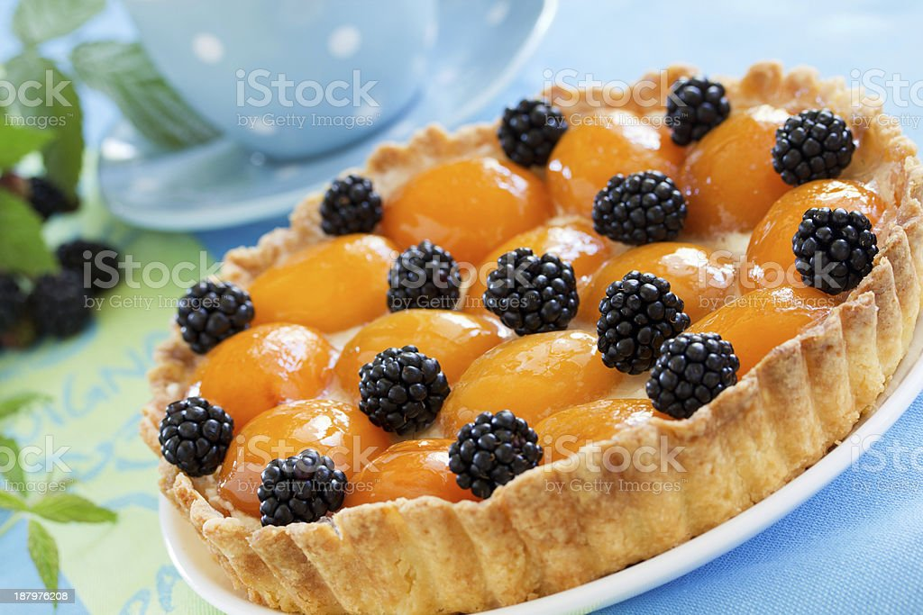 tart with peaches and blackberries. stock photo