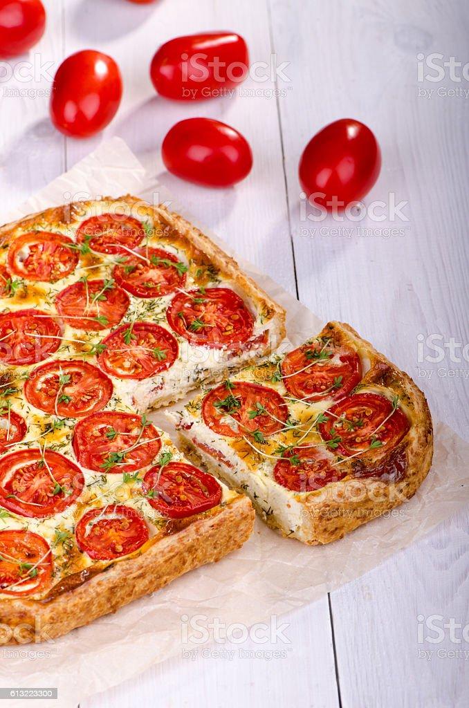 Tart with tomato and fresh herbs stock photo
