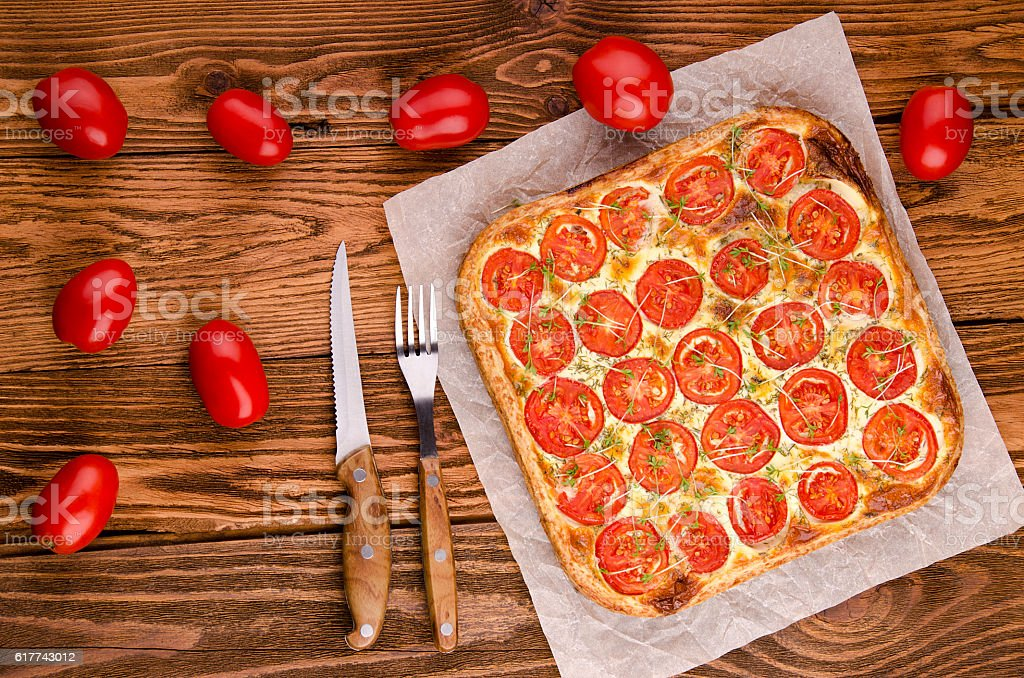 Tart with tomatoes, top view stock photo