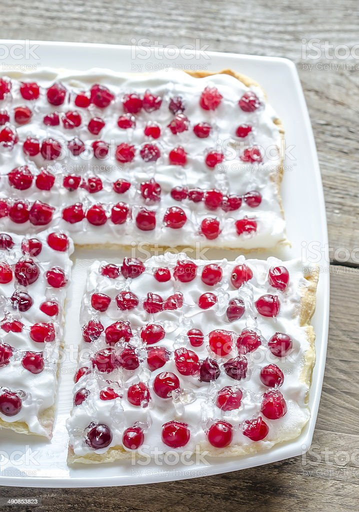 Tart with whipped cream and fresh cranberries royalty-free stock photo