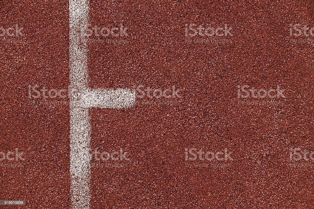 tartan track rubber standard red color and white line stock photo