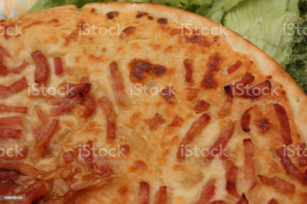 Tarte flambée Alsacienne aux lardons et crème fraîche stock photo