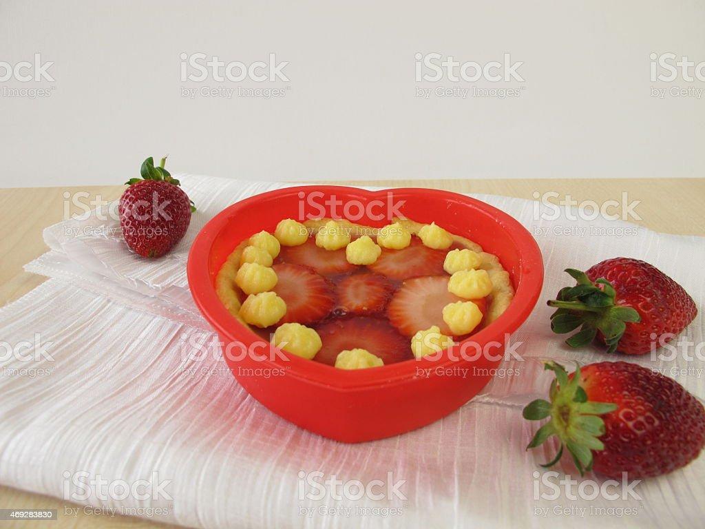 Tartelet heart with strawberries stock photo