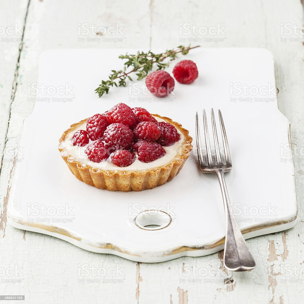 Tartlet with raspberries stock photo