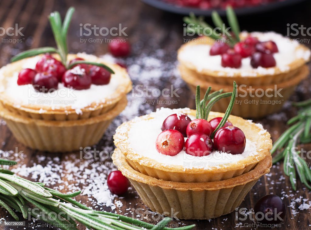 Tartlets of pastry with cream and fresh berries ripe cranberries stock photo