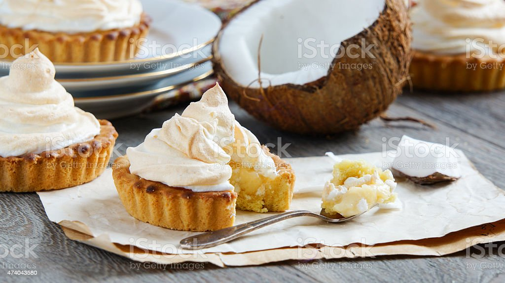 tartlets with coconut cream and meringue stock photo