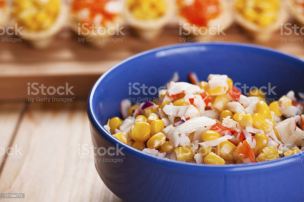 Tartlets with crab salad and corn royalty-free stock photo