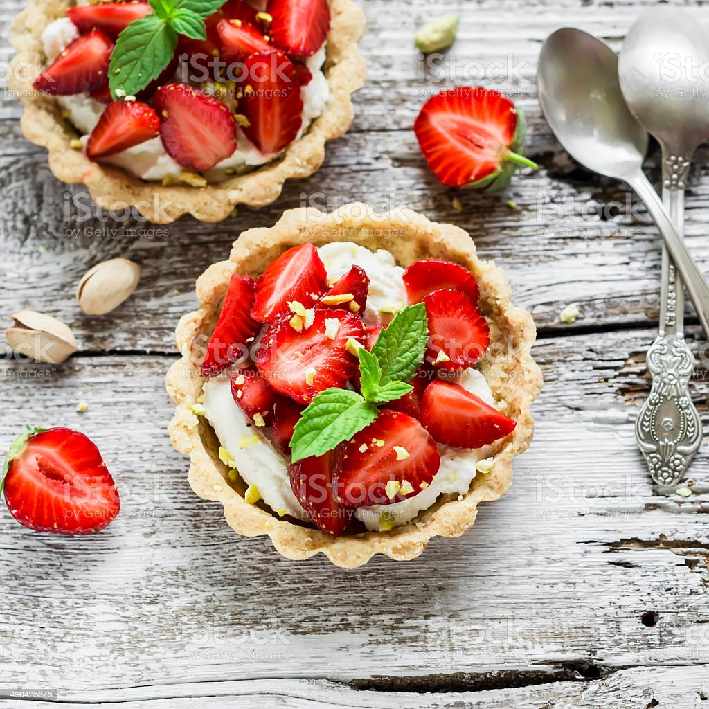 tartlets with cream cheese and strawberries stock photo