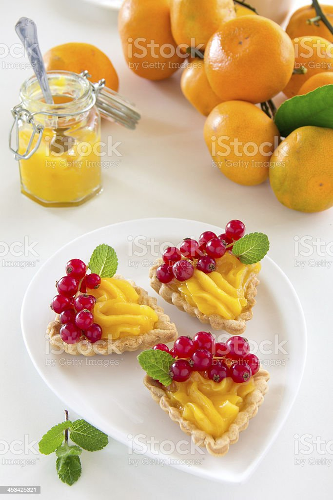 Tartlets with lemon cream and currant. stock photo