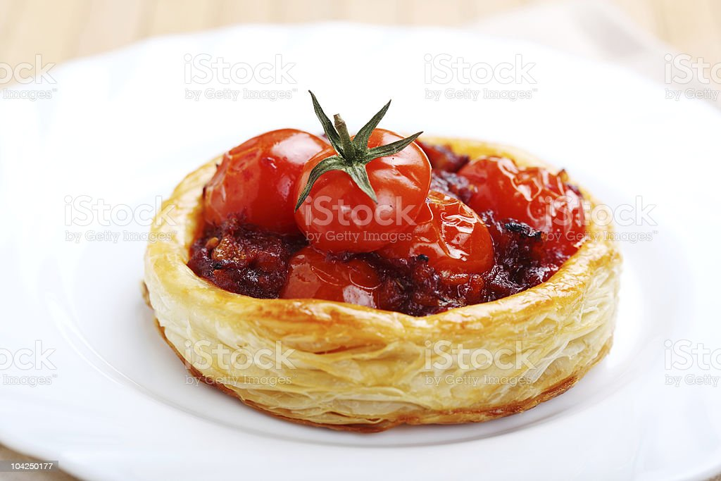 tartlets with ripe cherry tomatoes stock photo