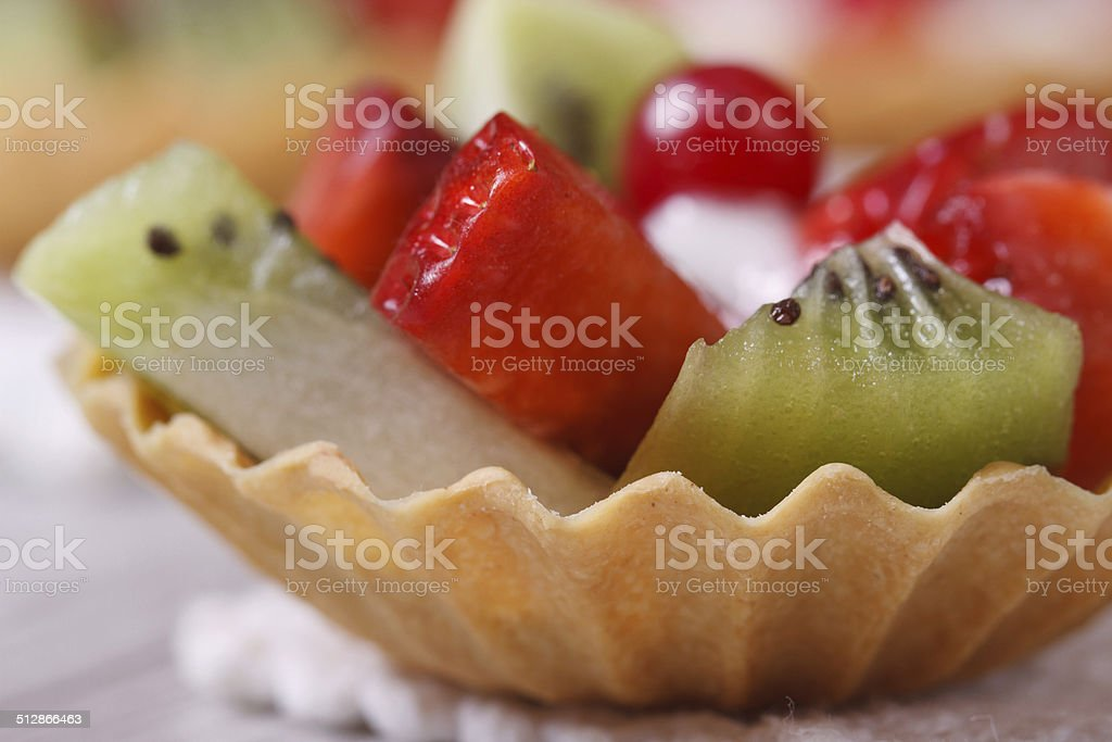tartlets with strawberries, kiwi and cranberries macro stock photo