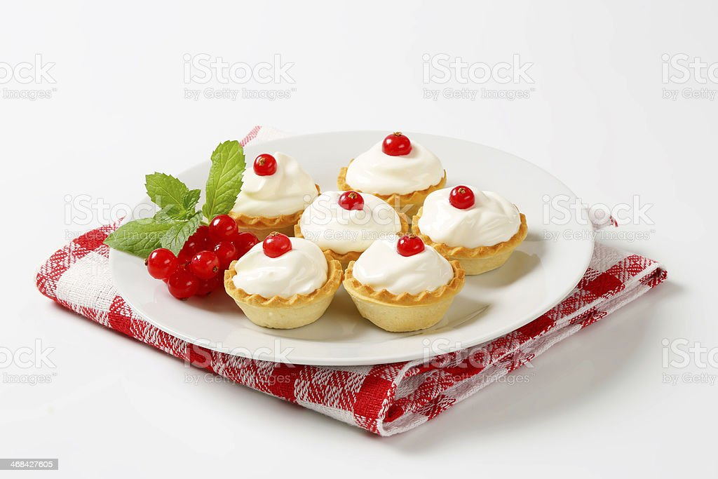 tartlets with whipped cream and red currant royalty-free stock photo