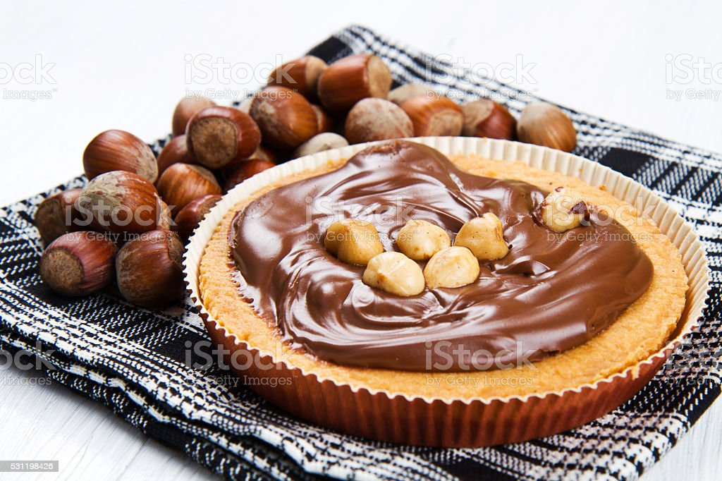 tartlette with chocolate and hazelnut cream stock photo