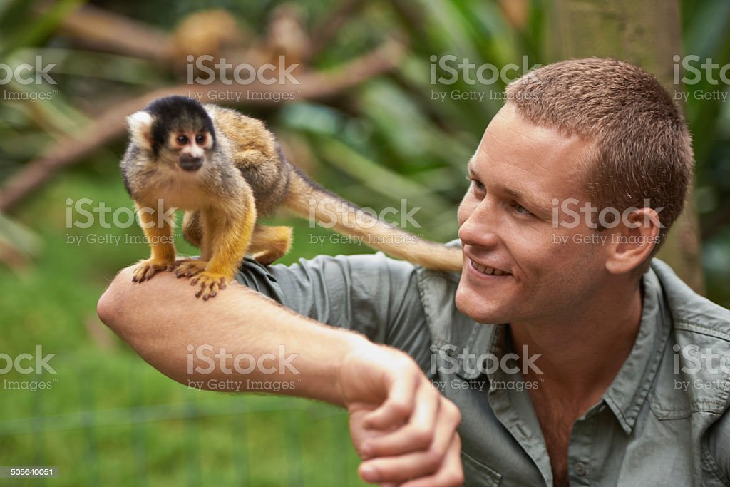 Tarzan loved spending time with his little friend stock photo