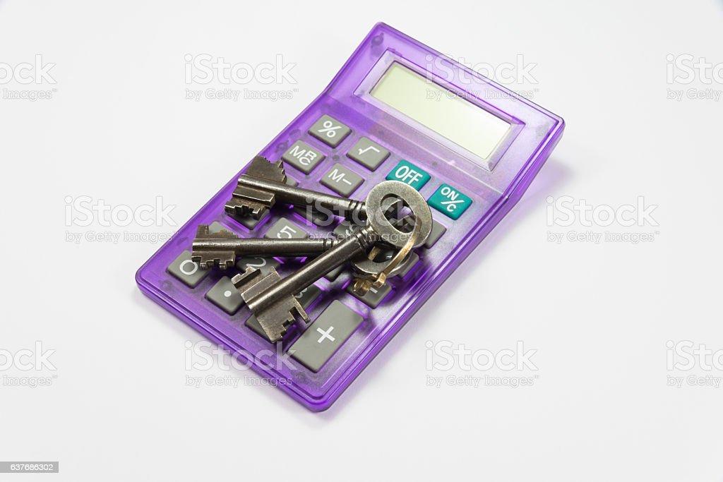 Taschenrechner und Schlüssel stock photo