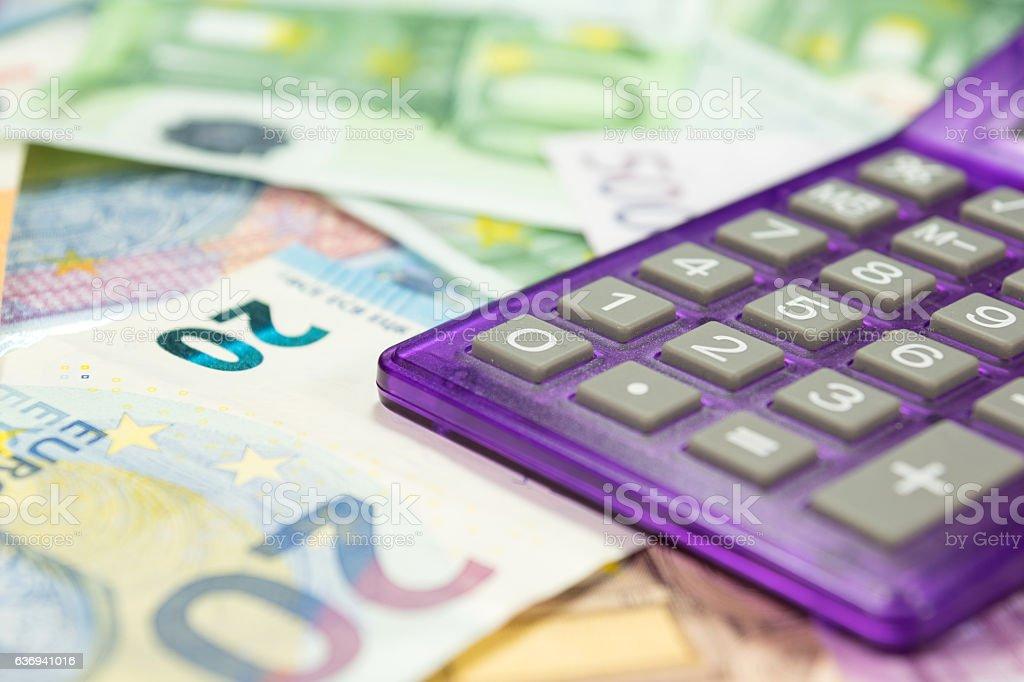Taschenrechner und viele Euro Geldscheine stock photo