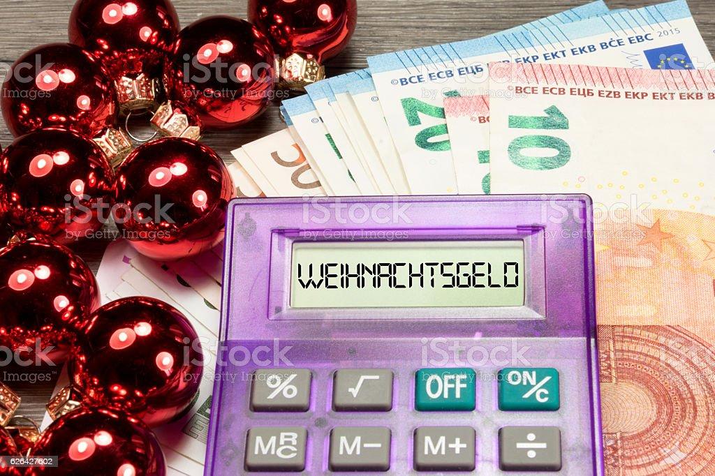 Taschenrechner und Weihnachtsgeld stock photo