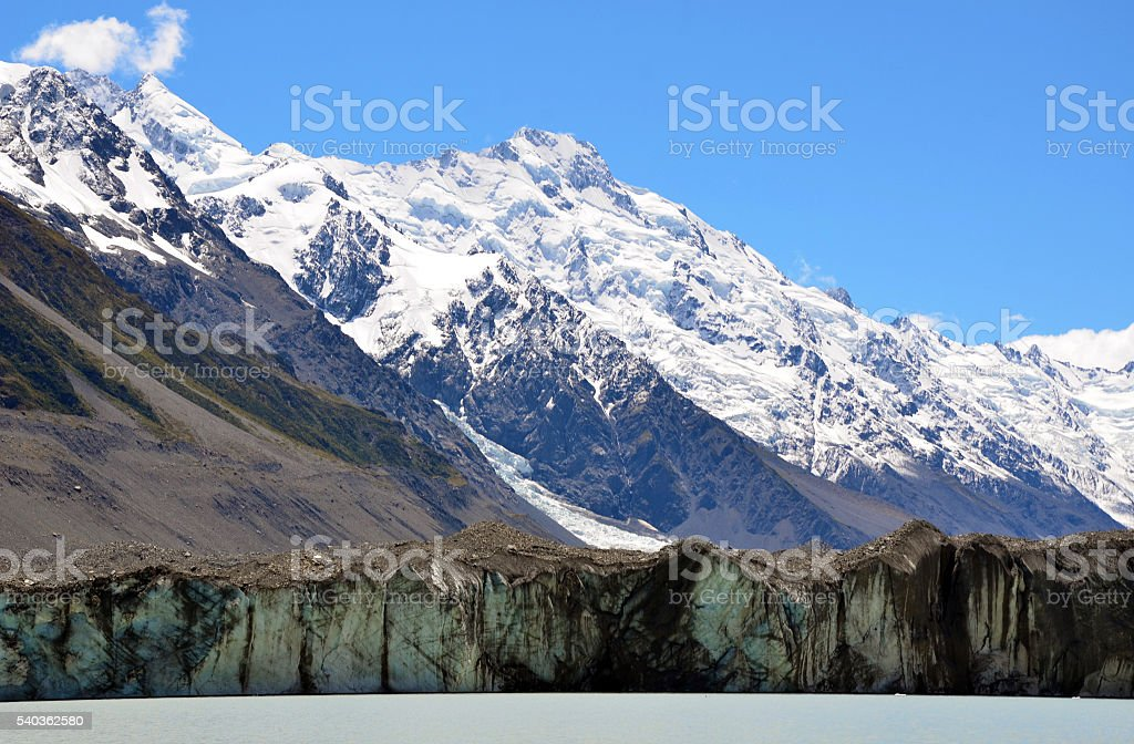 Tasman Glacier at the foot of snow covered mountains stock photo