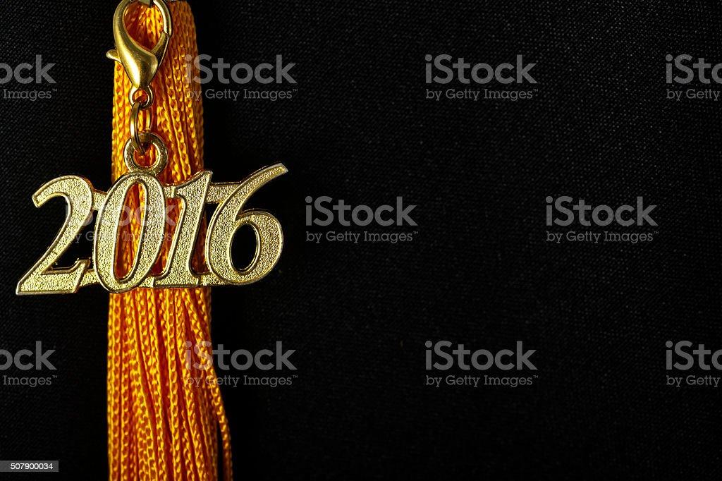 Tassel with 2016 pendant on black graduation hat stock photo