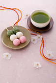 Tassels, green tea and dango on washi paper