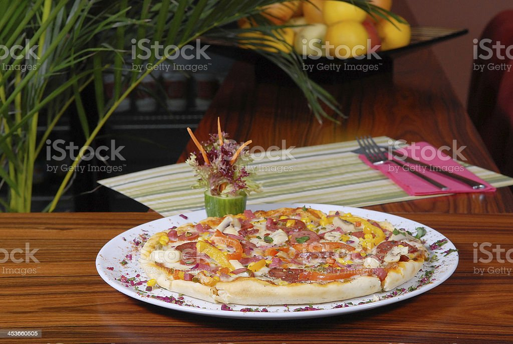 Tasteful pizza in the restaurant royalty-free stock photo