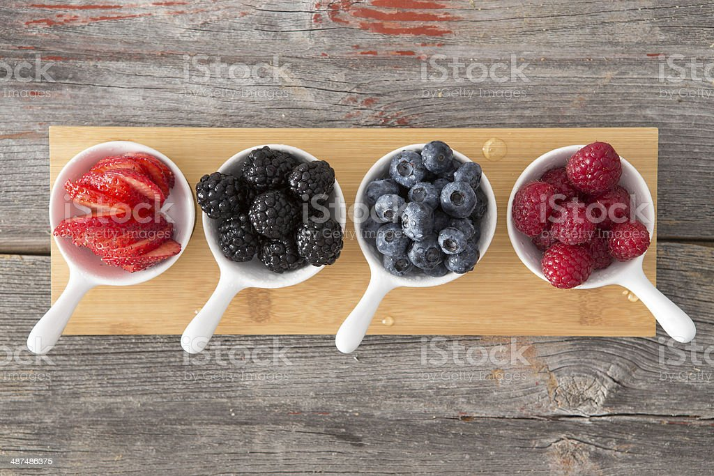 Taster dishes of assorted autumn berries stock photo