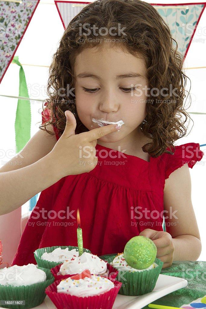 Tasting birthday's cake stock photo