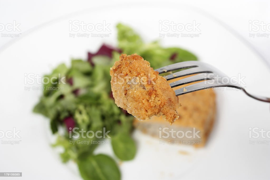 Tasting cutlet with salad royalty-free stock photo