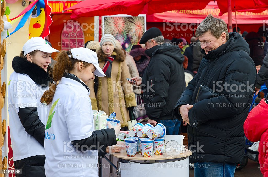 Tasting of dairy products at fair during Shrovetide festivities stock photo