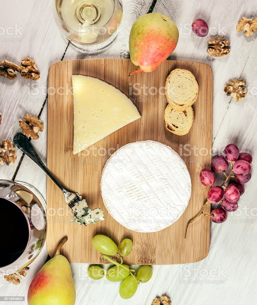 Tasting with glasses of wine and different cheese types stock photo