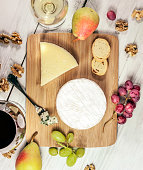 Tasting with glasses of wine and different cheese types