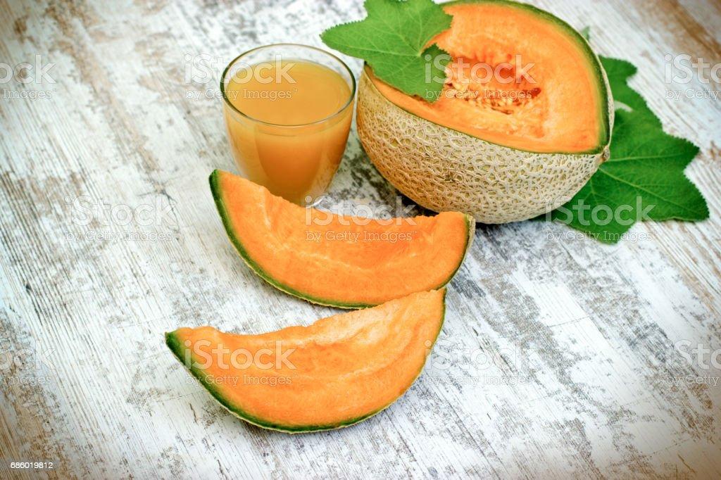 Tasty and juicy melon - cantaloupe and melon juice (smoothie) stock photo