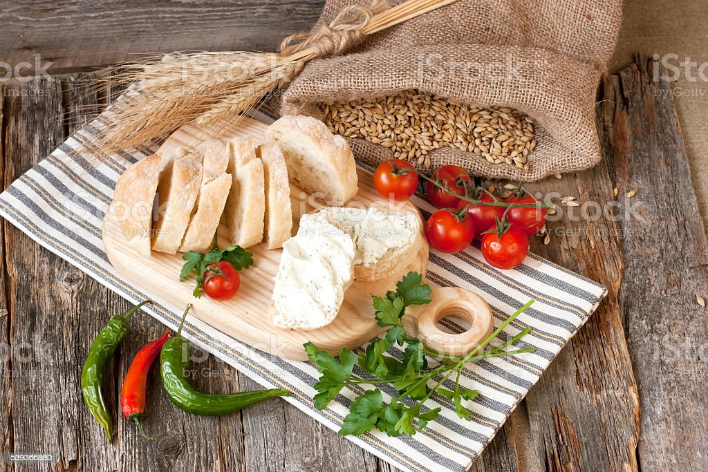 Tasty baguette  with cheese cream  a wooden board stock photo