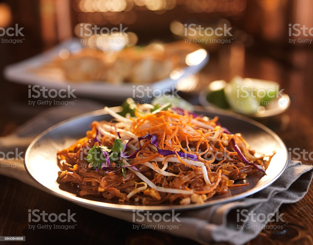 tasty beef pad thai meal with colorful garnishing stock photo