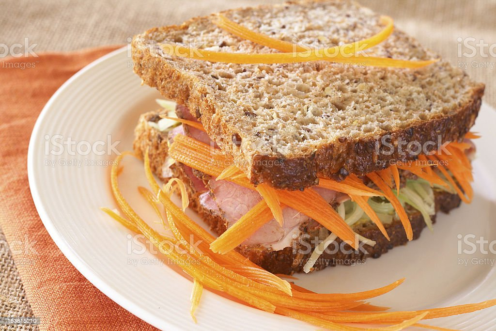 Tasty beef sandwich on wholewheat bread royalty-free stock photo