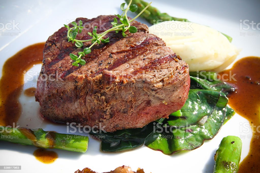 Tasty Beef Steak with Gravy stock photo