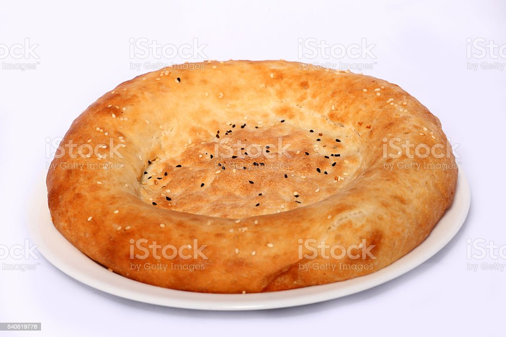 Tasty bread cake on the plate on white background stock photo